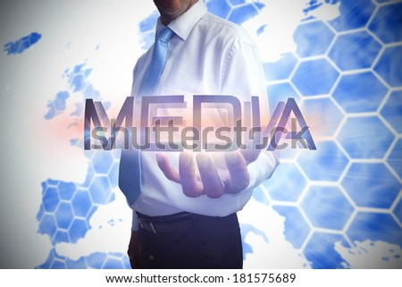 Businessman presenting the word media against background with europa map - stock photo