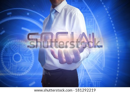 Businessman presenting the word social against futuristic shiny blue design