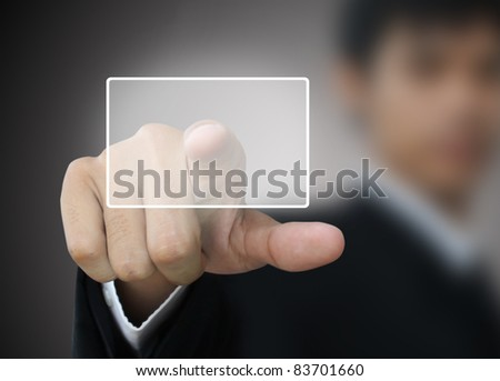 Businessman press button - stock photo