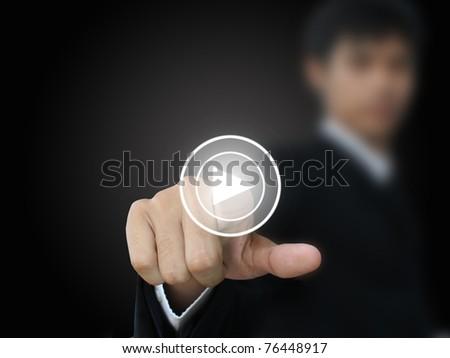 Businessman press play button - stock photo
