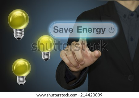 Businessman press the button Save energy. - stock photo