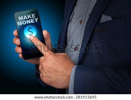 Businessman presses a button touch screen make money on smatrfona. Business, technology, internet and networking concept - stock photo
