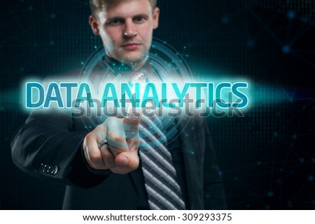 Businessman presses button data analytics on virtual screens. Business, technology, internet and networking concept. - stock photo