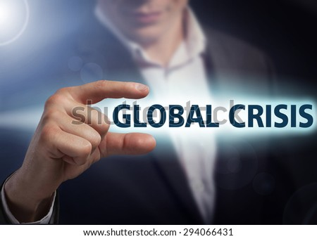 Businessman presses button global crisis on virtual screens. Business, technology, internet and networking concept. - stock photo