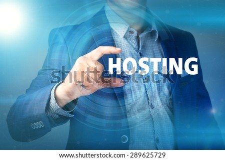 Businessman presses button hosting on virtual screens. Business, technology, internet and networking concept. - stock photo