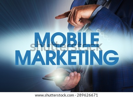 Businessman presses button mobile marketing on virtual screens. Business, technology, internet and networking concept. - stock photo