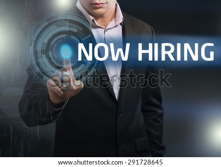 Businessman presses button now hiring on virtual screens. Business, technology, internet and networking concept. - stock photo