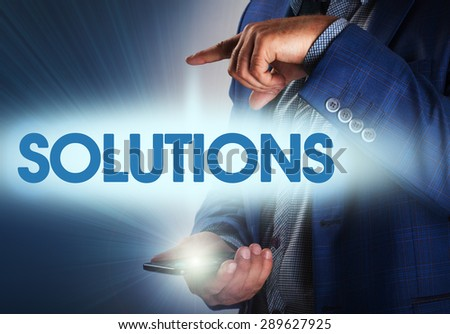 Businessman presses button solutions on virtual screens. Business, technology, internet and networking concept. - stock photo