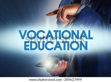 Businessman presses button vocational education on virtual screens. Business, technology, internet and networking concept. - stock photo
