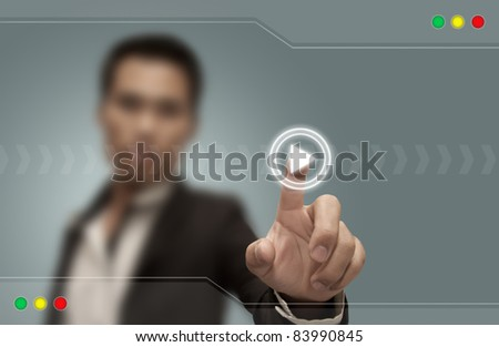 Businessman presses the button on the touch screen.