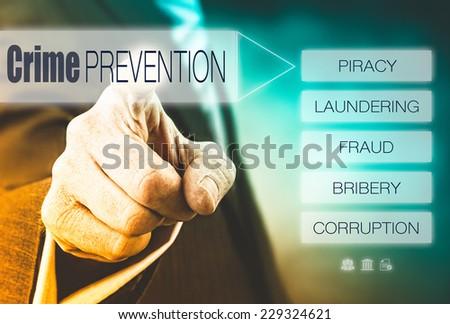 Businessman pressing a Crime Prevention concept button. - stock photo