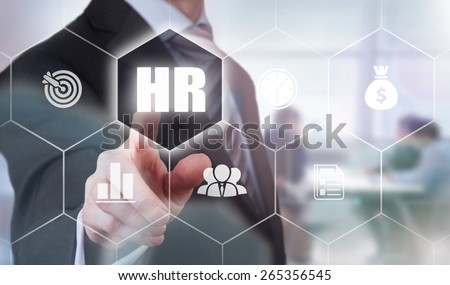 Businessman pressing a Human Resources concept button. Instagram type styling applied. - stock photo