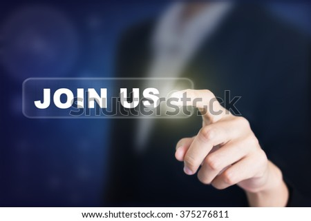 Businessman pressing a JOIN US concept button. Can be used in advertising. - stock photo
