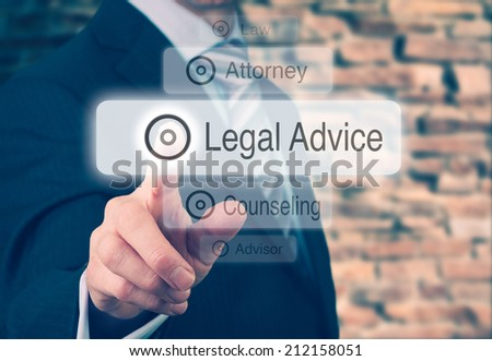 Businessman pressing a Legal Advice concept button. Instagram styling applied. - stock photo