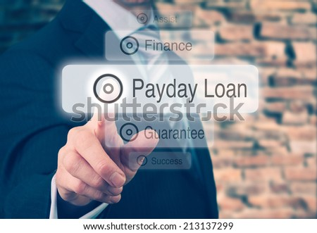 Businessman pressing a Payday Loan concept button. Instagram Styling Applied. - stock photo