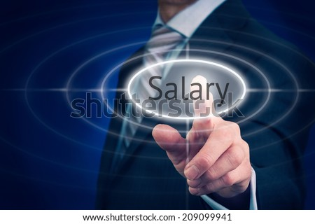 Businessman pressing a Salary concept button. - stock photo