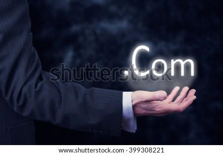 Businessman pressing an .com concept button. - stock photo