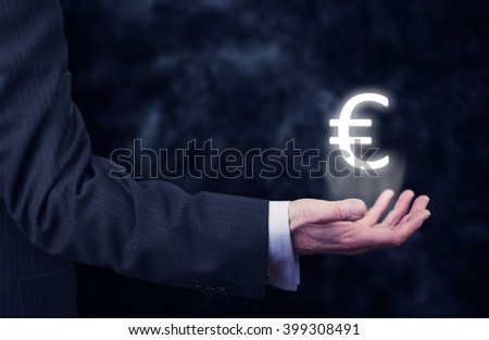 Businessman pressing an â?¬ concept button.