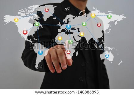 Businessman pressing an imaginary button - stock photo