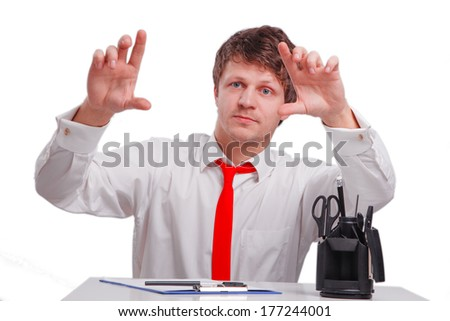 Businessman pressing an imaginary button on bokeh isolated on white - stock photo