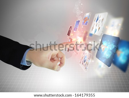Businessman pressing business diagram  - stock photo