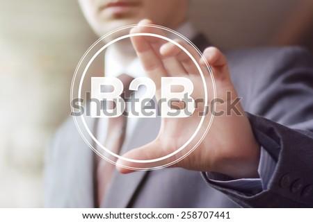 Businessman pressing button b2b icon web - stock photo