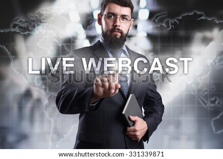 Businessman pressing button live webcast on the virtual screen. Business, internet and technology concept. - stock photo