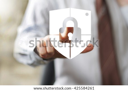 Businessman pressing button locked shield virus security - stock photo