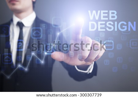 """Businessman pressing button on the virtual screen and select """"Web design"""". business concept. Internet concept. - stock photo"""