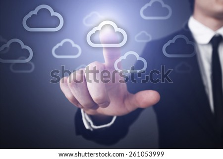 Businessman pressing button on touch screen interface and select cloud icon business concept. - stock photo