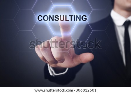 "Businessman pressing button on touch screen interface and select ""Consulting"". Business concept. Internet concept. - stock photo"