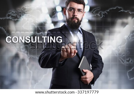 Businessman pressing button on touch screen interface and select Consulting. Business concept. Internet concept. - stock photo