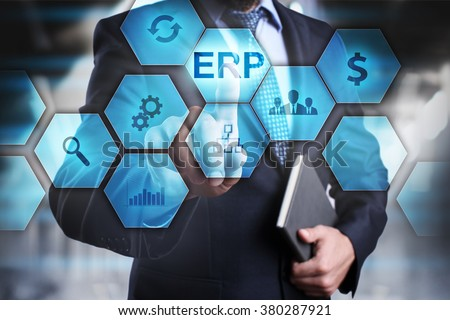 """Businessman pressing button on touch screen interface and select """"ERP"""". Business concept. Internet and technology concept. - stock photo"""