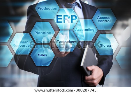 "Businessman pressing button on touch screen interface and select ""ERP"". Business concept. Internet and technology concept. - stock photo"