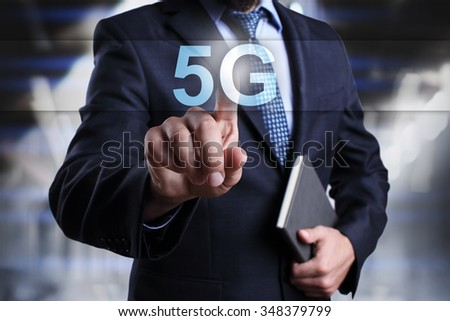 Businessman pressing button on touch screen interface and select 5G. Business, internet, technology concept. - stock photo