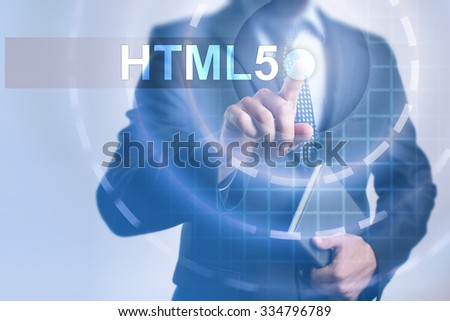 Businessman pressing button on touch screen interface and select HTML5. Business, internet, technology concept.