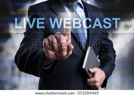 Businessman pressing button on touch screen interface and select Live webcast. Business concept. Internet concept. - stock photo