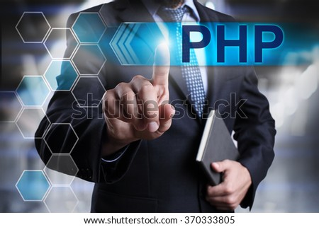 """Businessman pressing button on touch screen interface and select """"PHP"""". Business concept. Internet concept. - stock photo"""