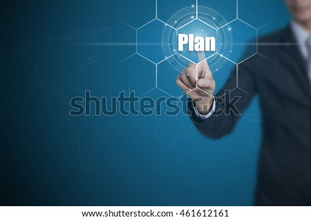 Businessman pressing button on touch screen interface and select Plan, Business concept.