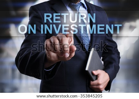 "Businessman pressing button on touch screen interface and select ""Return on investment"". Business concept. Internet concept. - stock photo"