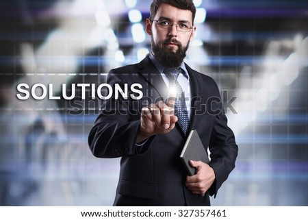 Businessman pressing button on touch screen interface and select Solutions. Business concept. Internet concept. - stock photo
