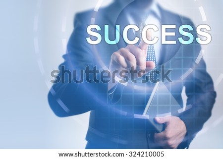 Businessman pressing button on touch screen interface and select Success. Business, internet, technology concept.