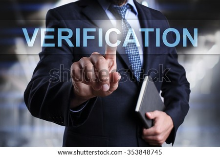 "Businessman pressing button on touch screen interface and select ""Verification"". Business concept. Internet concept. - stock photo"