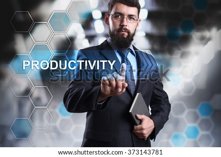 "Businessman pressing button on touch screen interface and selecting ""Productivity"". Business, internet and tehcnology concept. - stock photo"