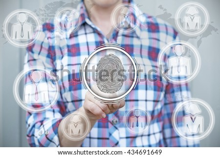 Businessman pressing button with finger print reader. Electronic security, access through a fingerprint reader - stock photo
