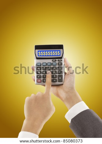 businessman pressing calculator ,golden background - stock photo