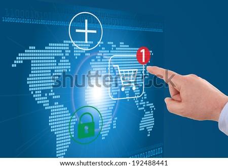 businessman pressing cart button on world map - modern online shopping - stock photo