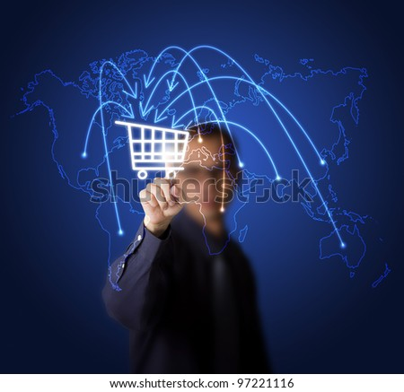 businessman pressing cart button on world map -  symbol of modern online marketing and shopping - stock photo