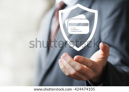Businessman pressing credit card shield security - stock photo