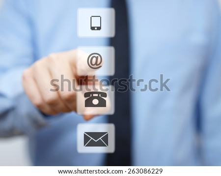 businessman pressing email button, company support icons - stock photo